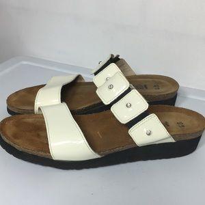 NAOT cream rhinestone leather slide sandals. 9.